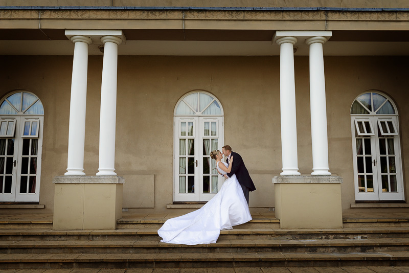 romantic picture of bride and groom at down hall on their wedding day