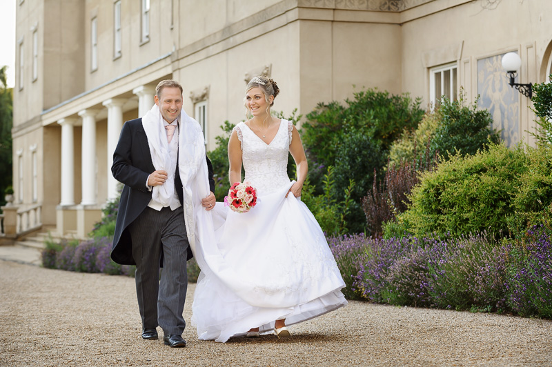 bride and groom walking at down hall