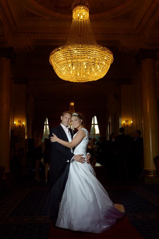 down hall chandelier wedding portrait