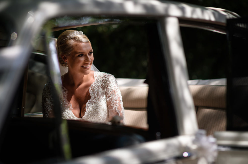 Bride in wedding car wedding photographed in essex